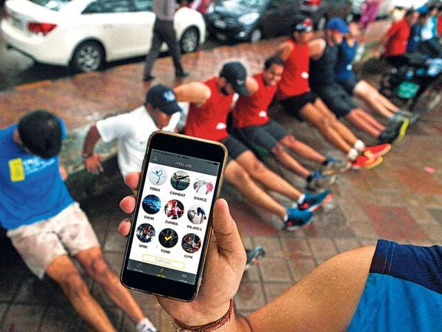 Martial arts today, land surfing tomorrow. New apps are allowing busy fitness enthusiasts to toggle between gyms, workout types and trainers, offering access across brands and pay-as-you-go options. Members at Fiticket at Shivaji Park in Delhi. (HT Photo)