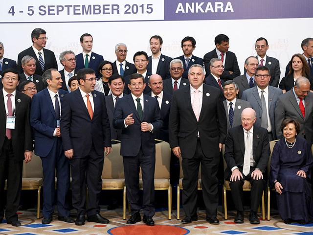 Turkey's Prime Minister Ahmet Davutoglu (first row 5th L) gestures next to finance ministers and central bank governors prior to a group photo during the second day of a two-day G20 meeting of finance ministers and central bank governors in Ankara on September 5 (AFP Photo)