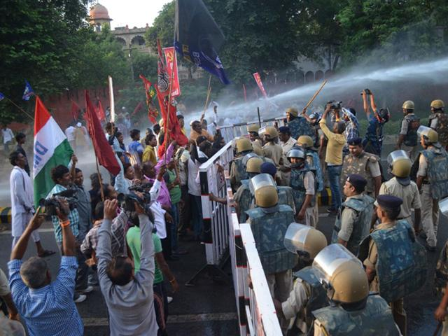 Workers of various political parties clashed with police during CM Shivraj Singh Chouhan's visit to Gwalior on Sunday. (HT photo)