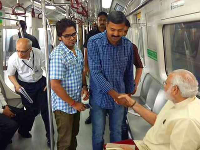 Prime Minister Narendra Modi travels by Delhi Metro to inaugurate the extension of the Badarpur Line that will connect the satellite city of Faridabad to the national capital. (Photo courtesy: @PMOIndia)