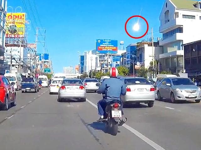 A screengrab of a video recorded on a dashboard car camera in Bangkok shows a fireball followed by a brilliant white flash.