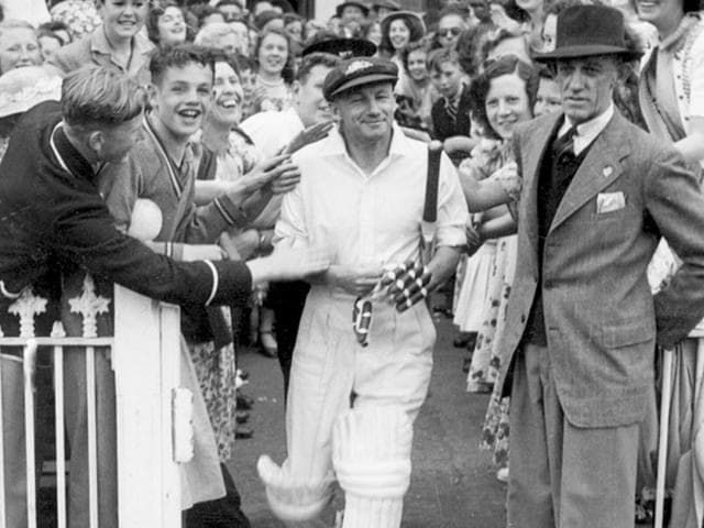 Retired Australian captain Don Bradman makes his way onto the MCG in 1948 for his testimonial match in Melbourne, Australia. (Getty Images)