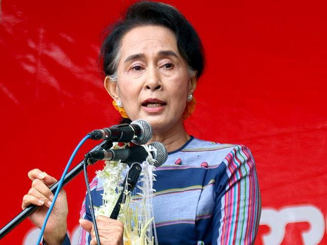 """Myanmar opposition leader Aung San Suu Kyi speaks during her """"Election Awareness Tour"""" in Ho-Pong township in Pa-O self-administrative zone, southern Shan State, Myanmar. (AP Photo)"""