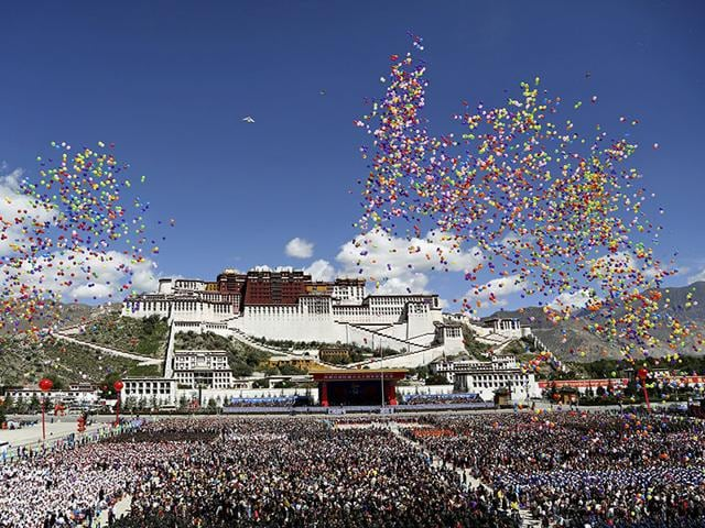 Balloons are released during the celebration event at the Potala Palace marking the 50th anniversary of the founding of the Tibet Autonomous Region, in Lhasa, Tibet Autonomous Region, China. (Reuters)