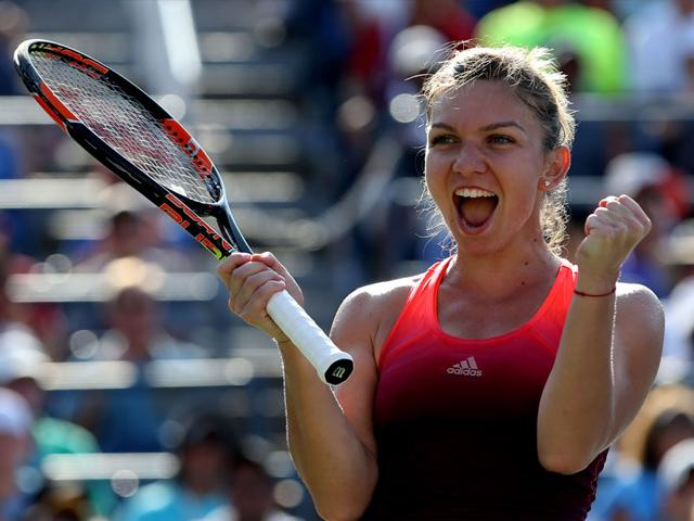 Simona Halep of Romania celebrates defeating Sabine Lisicki of Germany in the women's singles fourth-round match of the 2015 US Open at the USTA National Tennis Center in New York, on September 7, 2015. (AFP Photo)