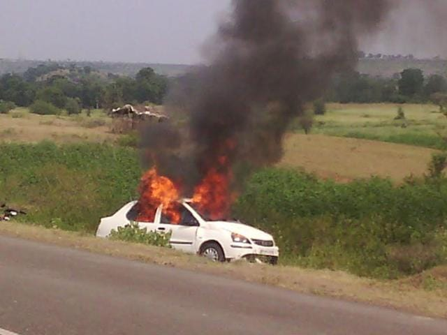 The car torched by the villagers after the accident in Barwani. (HT photo)