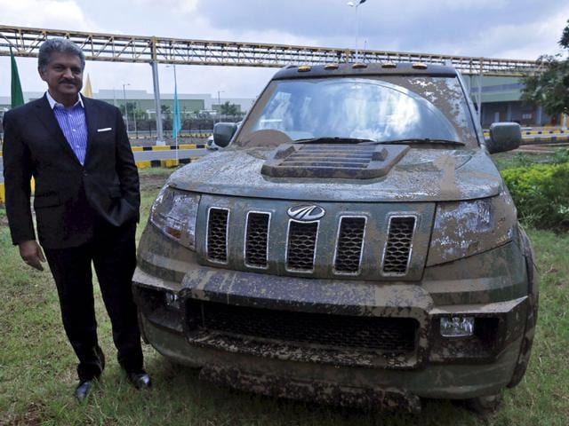 HARDCORE! M&M chairman and MD Anand Mahindra with the new compact SUV TUV300 in Pune on Thursday. Photo:Reuters
