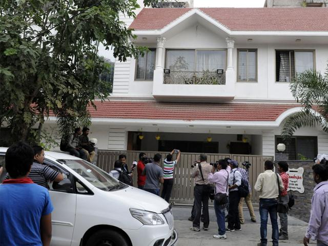 Scribes and cameramen outside the house of businessman Mohan Kumar Ludhiyani in Indore on Friday. (Shankar Mourya/HT photo)