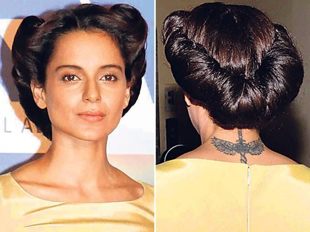 Kangana Ranaut sporting a 40's inspired rolled updo at an event.