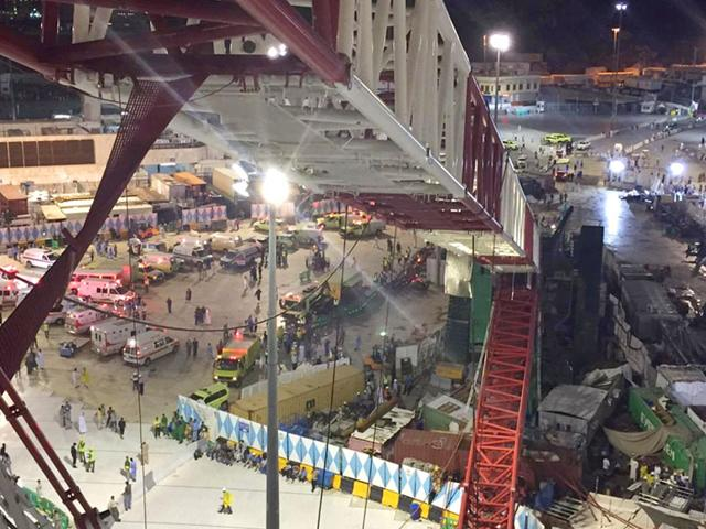 A collapsed crane and emergency services vehicles are seen near the Grand Mosque in Mecca, Friday, Sept. 11, 2015. The accident happened as pilgrims from around the world converged for the annual Hajj pilgrimage, which takes place this month, killing dozens. (AP Photo)