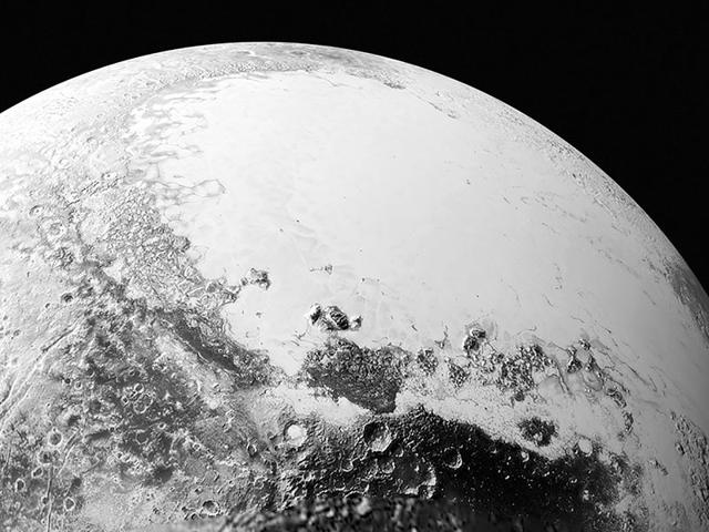 A synthetic perspective view of Pluto, based on the latest high-resolution images to be downlinked from Nasa's New Horizons spacecraft, shows what you would see if you were approximately 1,100 miles (1,800 kilometers) above Pluto's equatorial area, looking toward the bright, smooth, expanse of icy plains informally called Sputnik Planum. (Reuters Photo)