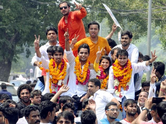 ABVP supporters celebrate after the results of DUSU elections were announced. (Sonu Mehta/HT Photo)