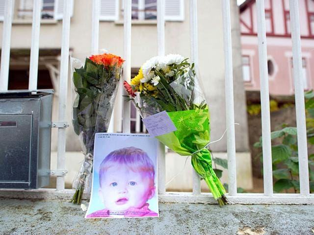 File photo of three-year-old Bastien at the entrance of the parents' house in Germigny-l'Eveque, east of Paris. (AFP Photo)