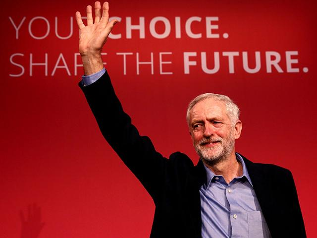 The new leader of Britain's opposition Labour Party Jeremy Corbyn waves after making his inaugural speech at the Queen Elizabeth Centre in central London. (Reuters)