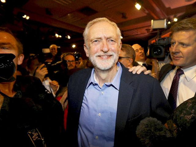 Jeremy Corbyn smiles as he leaves the stage after he is announced as the new leader of The Labour Party during the Labour Party Leadership Conference in London. (AP Photo)
