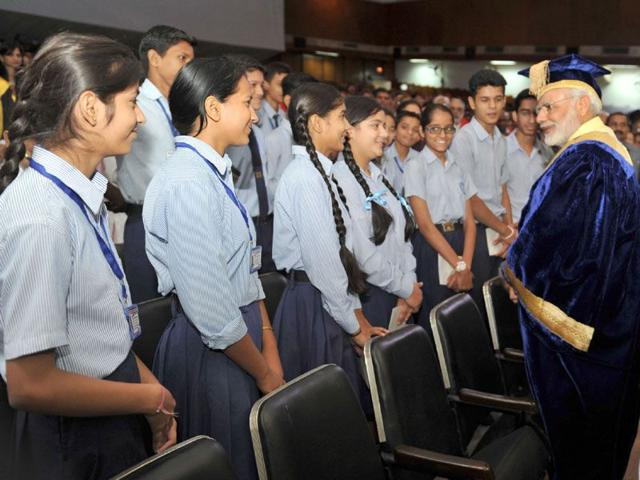 Students of government schools interacting with Prime Minister Narendra Modi at the PGIMER on Friday. (HT Photo)