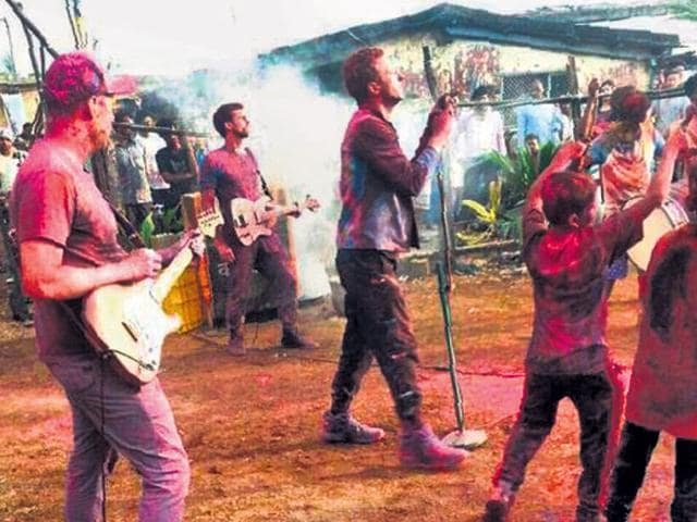 Coldplay performing in India.