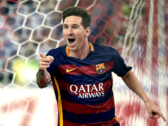 Barcelona star Lionel Messi celebrates after scoring during the Spanish league (La Liga) match between Atletico Madrid and Barcelona at the Vicente Calderon stadium in Madrid on September 12, 2015. (AFP Photo)