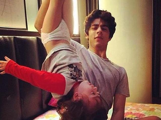 When Shah Rukh Khan's kids play: Aryan turns AbRam upside down! (Photo: Twitter/ShahRukhKhan)