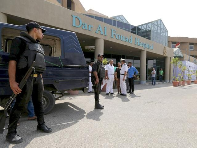 Egyptian police personnel stand guard outside Dar Al Fouad Hospital, where injured tourists who were mistakenly targeted in a military operation