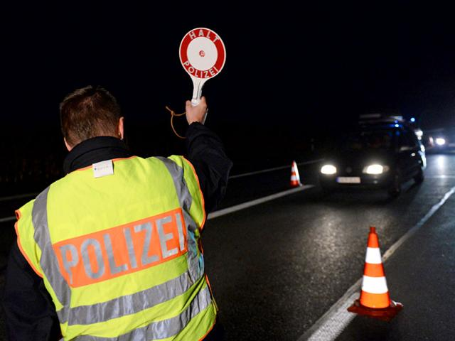 German police stop cars and check people traveling on the A8 motorway at the German-Austrian border near Bad Reichenhall. Germany imposed emergency border controls with Austria to stem the tide of refugees. (EPA Photo)