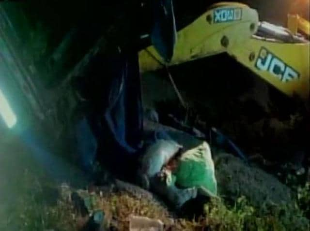 The lorry carrying about 35 agricultural labourers tilted at Gandepalli in east Godavari district in the early hours on Monday. 16 bodies have been recovered till now. (ANI Photo)