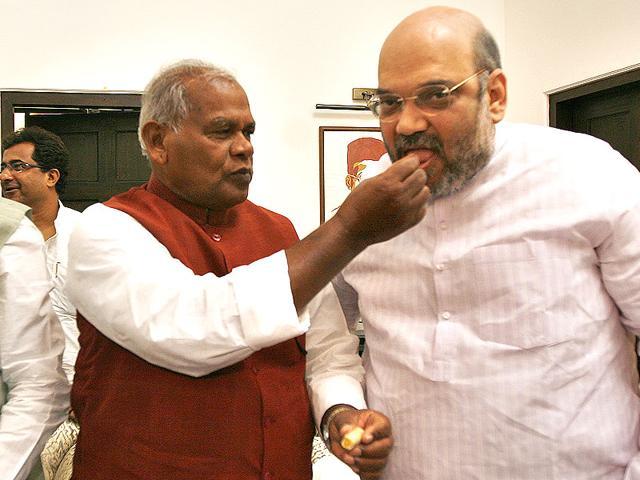 Hindustani Avam Morcha (Secular) chief Jitan Ram Manjhi with BJP president Amit Shah at his Delhi residence. (Arun Sharma/HT)