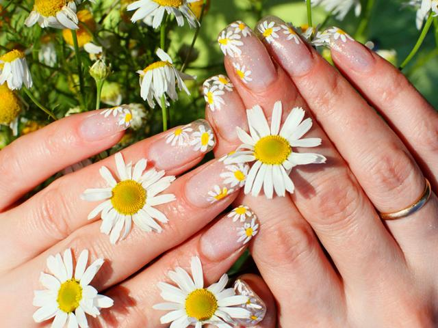 It's time to stop biting -- and start pampering -- your nails. Getting regular manicures could make them too pretty to bite, says a dermatologist who shares her advice on quitting. (Shutterstock Photo)