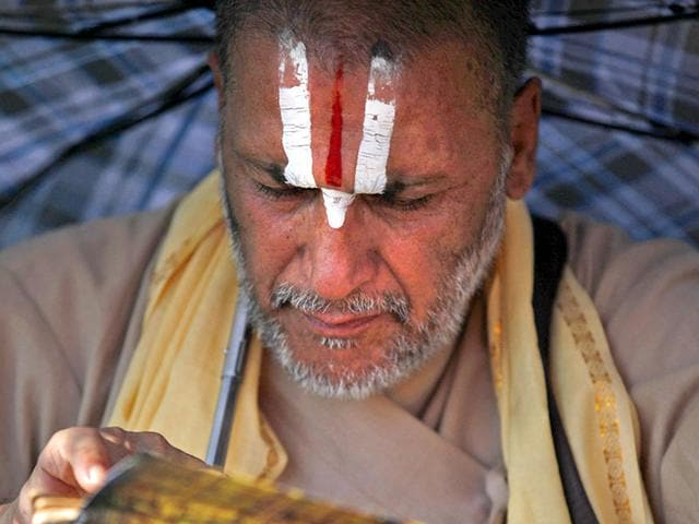 A Nepalese Hindu priest performs rituals during Kuse Aunsi, or Nepalese Father's Day, at the Gokarneshwar Hindu temple in Kathmandu, Nepal. (AP Photo)
