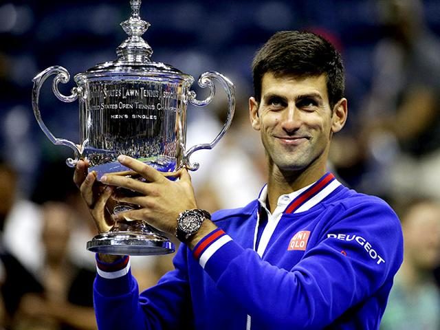 Novak Djokovic of Serbia holds up the US Open trophy after defeating Roger Federer of Switzerland in their men's singles final match at the US Open Championships tennis tournament in New York. (Reuters)