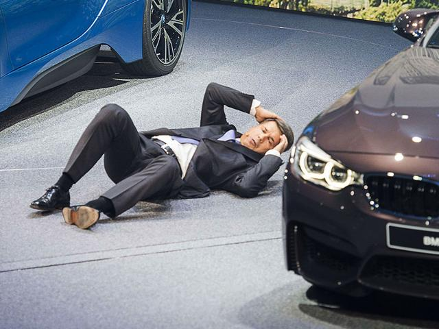 BMW's chief executive officer, Harald Krueger, fainted at the Frankfurt Motor Show 2015 press conference. (AFP Photo)