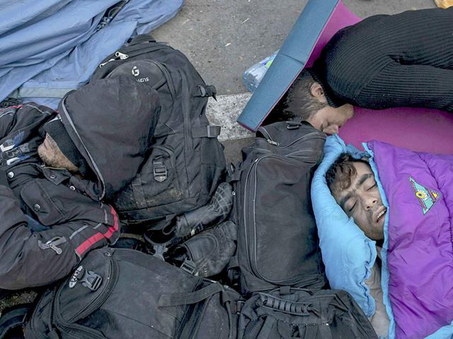 In Hungary, migrants sleep in front of a fence as they wait to enter the country, after the Hungarian police sealed the border with Serbia. (REUTERS)