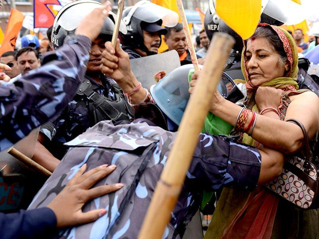 Nepalese police stop Hindu activists during a protest demanding Nepal be declared a Hindu state, in Kathmandu on Monday. (AFP Photo)