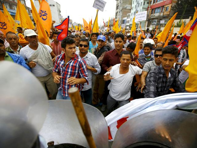 Hindu activists try to break through a restricted area near the parliament in Kathmandu during a protest rally demanding Nepal to be declared as a Hindu state in the new constitution. (Reuters/Navesh Chitrakar)