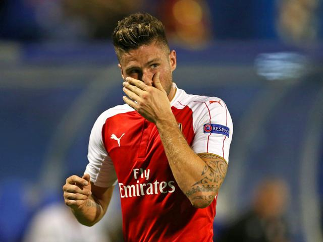 Arsenal's Olivier Giroud looks dejected after being sent off in his team's group stage encounter of the Uefa Champions League at Maksimir Stadium in Zagreb, Croatia, on September 16, 2015. (Reuters Photo)