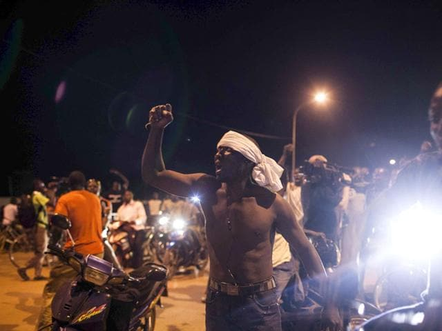 People demonstrate near the presidential palace after soldiers arrested Burkina Faso's transitional president and PM in Ouagadougou on Wednesday. (AP Photo)