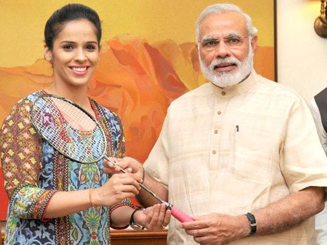 Prime Minister Narendra Modi with badminton player Saina Nehwal in New Delhi on September 16, 2015. (PTI Photo)