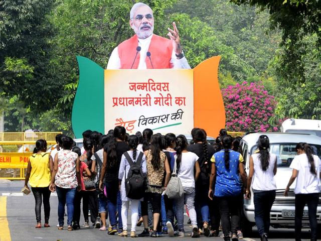 BJP supporters participating in 'Run for Development' on the occasion of Prime Minister Narendra Modi's 65th birthday in New Delhi. (Sonu Mehta/ HT Photo)