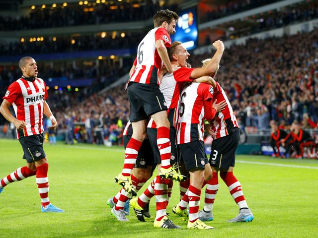 PSV Eindhoven's players celebrate after Hector Moreno scored the team's first goal in the Uefa Champions League group stage encounter against Manchester United at the Philips Stadion in Eindhoven, Netherlands, on September 15, 2015.(Reuters Photo)