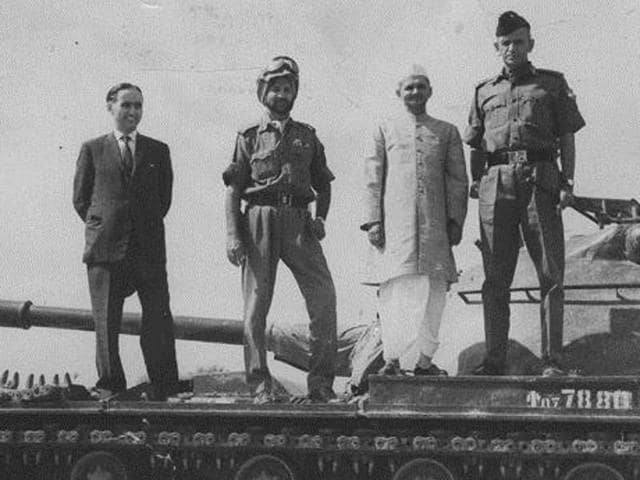The then prime minister Lal Bahadur Shastri and army officers atop a captured Pakistani tank.