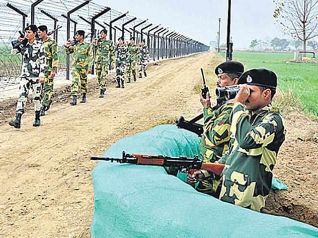 BSF jawans keep  watch along the Indo-Pakistan International Border in Amritsar.