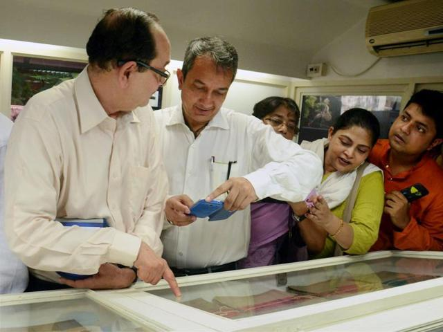 Netaji Subhash Chandra Bose's descendants take a look at confidential files on the freedom fighter in Kolkata Police Museum on Friday.