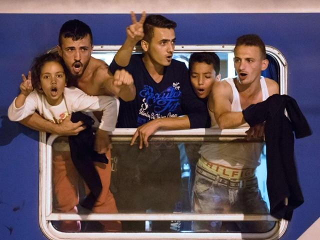 Migrants react as they wait in a train  near the Slovenian-Croatian border  seeking a new route into Europe's borderless Schengen area,  after Hungary fenced off its own border with Serbia.