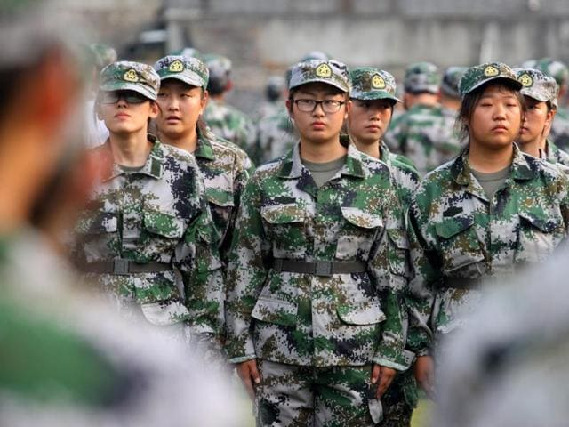 Drills and disciplinary action are part of China's military education program, which requires all university freshman to undergo stints of training designed to toughen up students