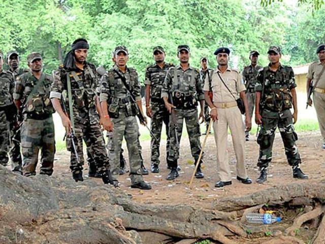 Police personnel at the spot where five women accused of practicing witchcraft were beaten to death in a village of Kinijia in Jharkhand on Saturday.(PTI)