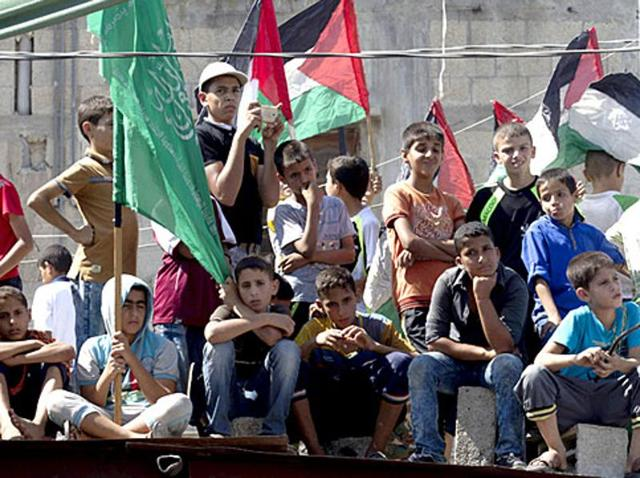 """Young Palestinian supporters of Hamas take part in an anti-Israeli protest in the southern Gaza Strip town of Khan Yunis, after Hamas called for a """"day of rage"""" following three days of clashes around Jerusalem's Al-Aqsa mosque compound."""