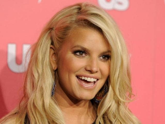 Jessica Simpson poses at Us Weekly's Annual Hot Hollywood Style Issue event, in Los Angeles.