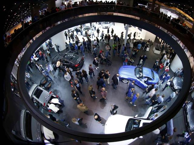 People visit the booth of German carmaker BMW at the Frankfurt Motor Show (IAA) in Frankfurt, Germany.