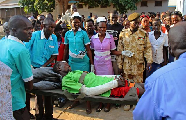 Burn victims wait to be evacuated to the capital Juba by plane for medical treatment, some of the many killed or injured when a truck carrying petrol overturned Wednesday and then exploded shortly after hundreds of villagers had gathered around to siphon fuel in South Sudan