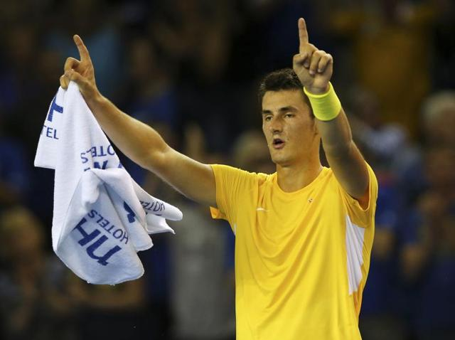 Australia's Bernard Tomic after beating Britain's Dan Evans in the Davis Cup semi-final second singles match at the Emirates Arena in Glasgow, Scotland, on September 18, 2015.